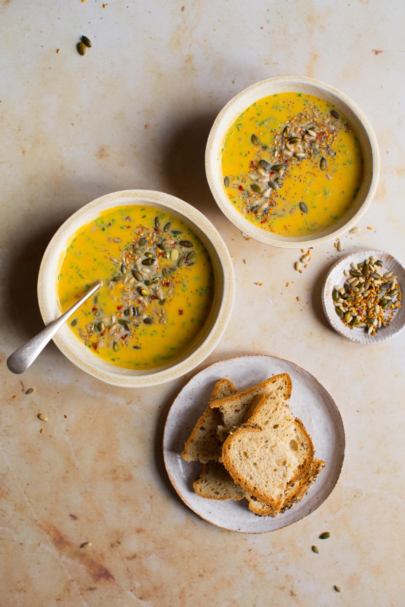 Butternut squash soup with toasted seeds served with Promise Gluten Free brown rolls